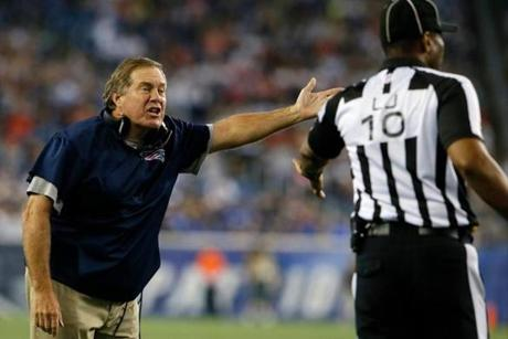 Patriots coach Bill Belichick had words with an official during Friday's preseason game against the Eagles.